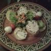 Gruß der Küche: Baguettescheiben mit würzigem Frischkäse