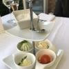 vier verschiedene frische Buttersorten