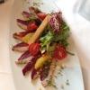 Geräucherte Entenbrust mit Chili-Honig Marinade, Orangenfilets und Kresse dazu Waldkräutersalat mit unserem Hausdressing und Baguette