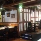 Foto zu Die Knolle - Das urige Kartoffelhaus: Gastraum der Knolle