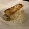 Steinbutt-Filet in brauner Butter mit Süßholz an der Gräte gebraten auf Herzmuschel-Sud