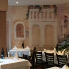 Foto zu La Ciacolada: Wandmalerei im Lokal
