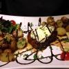 Argentinisches Rumpsteak vom Grill (200 g) mit Kräuterbutter, dazu ein kleiner gemischter Salat
