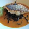 Seewolffilet auf Sepia-Nudeln mit Sauce Ratatouille