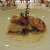 Duett von Seeteufel und Zander mit gegrilltem Scampi an Vermouthsauce