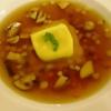 Strauchtomten-Consommé mit Ravioli