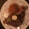 Filet-Teller bestehend aus Schweinefiletspieß, Lammfilet, Rinderfilet, serviert mit Tomatenreis, Kräuterbutter, Zaziki und Salat