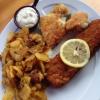 Seelachsfilet im Knuspermantel  plus halbe Portion Seehecht  mit Bratkartoffeln