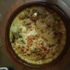 Ananasli Hindi Güvec-einen Putenfleischauflauf mit gerösteten Putenfleisch mit Ananas, Zwiebeln, Paprika, Currysauce und Käse überbacken für 13,50 €