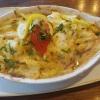 """""""Signalgast"""" ein gebackenes Lachsfilet belegt mit Zwiebeln, Zucchini, Tomate und Mozzarella, gratiniert, mit einem Hauch von Knoblauch mit Reis für 23,50 €"""