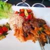 Tirjang - Lammkotelett nach arabischer Art, in leckerer Limetten-Aprikosensauce, dazu Gemüse. Reis, Cashewkerne und Salat 19,50 €