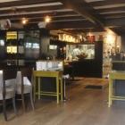 Foto zu Gourmetrestaurant Zur Post: Raum mit Blick Richtung Küche