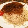 Wildragout in Preiselbeersauce an Haselnuß-Spaghetti und Salat der Saison