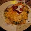 Enchilada con Pollo - 3 gedämpfte Maistortillas gefüllt mit Hähnchenbrustfilet, Tomaten, Mais und mit Käse überbacken und extra Salsa