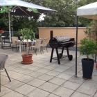 Foto zu TG Gaststätte Heddesheim: Terrasse mit Smoker.