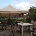 Foto zu TG Gaststätte Heddesheim: Sonnenschutz auf Terrasse